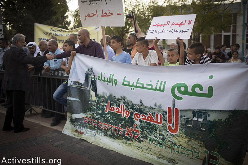 Residents of the unrecognised village of Dahamash protest in front of the municipality of Ramle. against house demolitions in their village, April 20, 2015. Oren Ziv / Activestills.org
