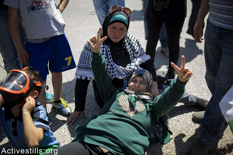 Manal Tamimi, a prominent figure of the popular struggle in her village, is being treated by medics after she was shot in the leg by an Israeli soldier with a live bullet, during the weekly protest against the occupation and settlements in Nabi Saleh, West Bank, April 3, 2015. Another Palestinian youth was also injured by live bullet in his leg. Anne Paq / Activestills.org