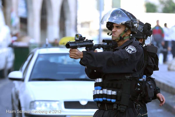 An Israeli Policeman prepares to fire a sponge-tipped bullet during a Nakba Day demonstration in East Jerusalem, May 15, 2013. (Haim Schwarczenberg)