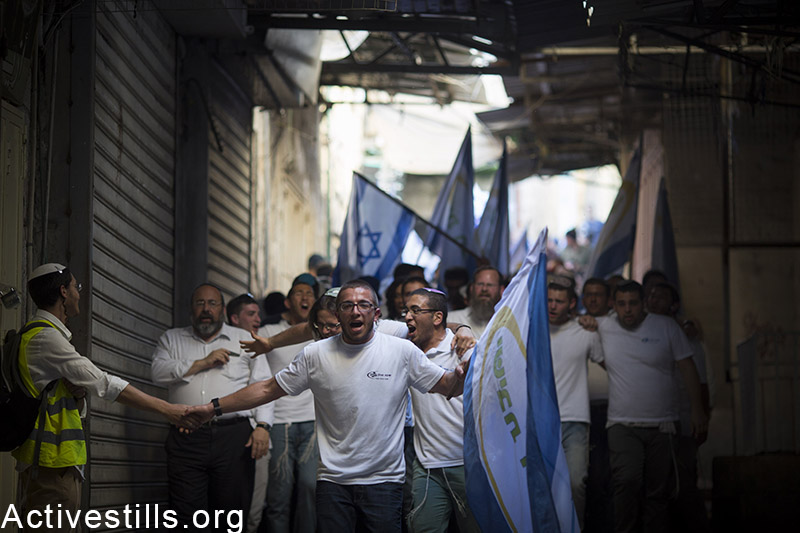 Israel youth walk in Jerusalem's old city, as they take part in the flags march, to celebrate 48 years for the occupation of East Jerusalem May 17, 2015.