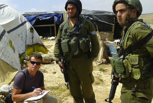 Civil Administration inspector in Susya ahead  of feared demolition (photo: Nasser Nawaj'a, B'Tselem)