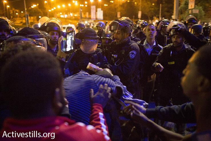 Ethiopian-Israelis clash with riot police at a protest against police brutality, Jerusalem, April 30, 2015. (Oren Ziv/Activestills.org)