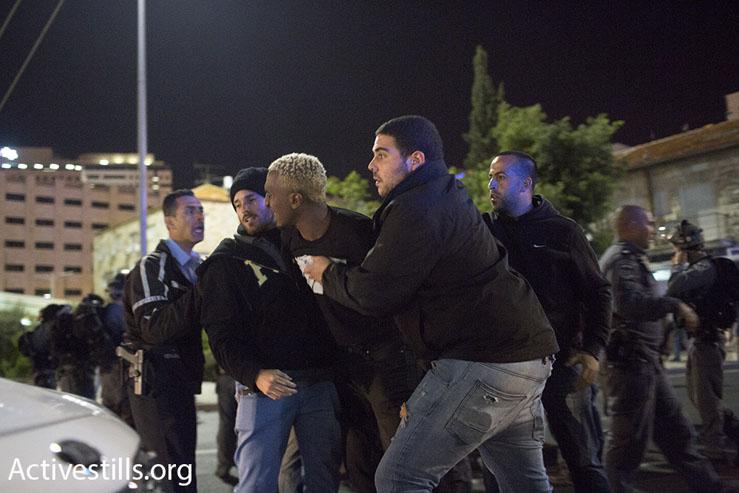 Police arrest an Ethiopian-Israelis protester at a demonstration against police brutality, Jerusalem, April 30, 2015. (Oren Ziv/Activestills.org)