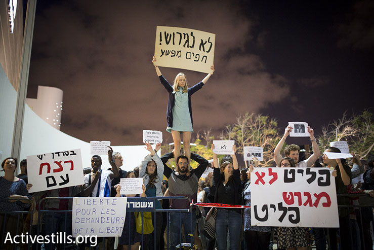 Israeli activists protest a proposed policy of giving African asylum seekers in Israel the option of indefinite imprisonment or 'self-deportation' to a third country, Tel Aviv, May 2, 2015. (Photo by Oren Ziv/Activestills.org)