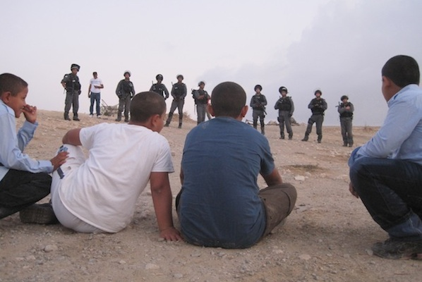 Bedouin children watch as Israeli forces come to demolish Al Araqib in August 2010 (Photo: Mairav Zonszein)