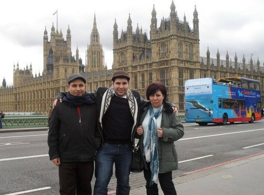 Sawsan (right), her son Laith (center) and husband Khaled (left) in the UK for Laith's Master's degree graduation ceremony, 2013.