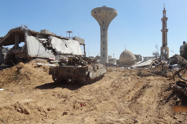 An Israeli tank amid the rubble of a destroyed mosque in the Gaza Strip during 2014's Operation Protective Edge. (Courtesy of Breaking the Silence)
