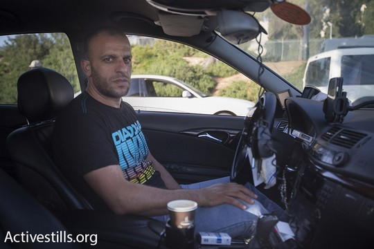 Thair Reg'i, who exposed Cinema City's discriminatory policies toward Arab cab drivers, is seen inside his taxi. (photo: Activestills.org)
