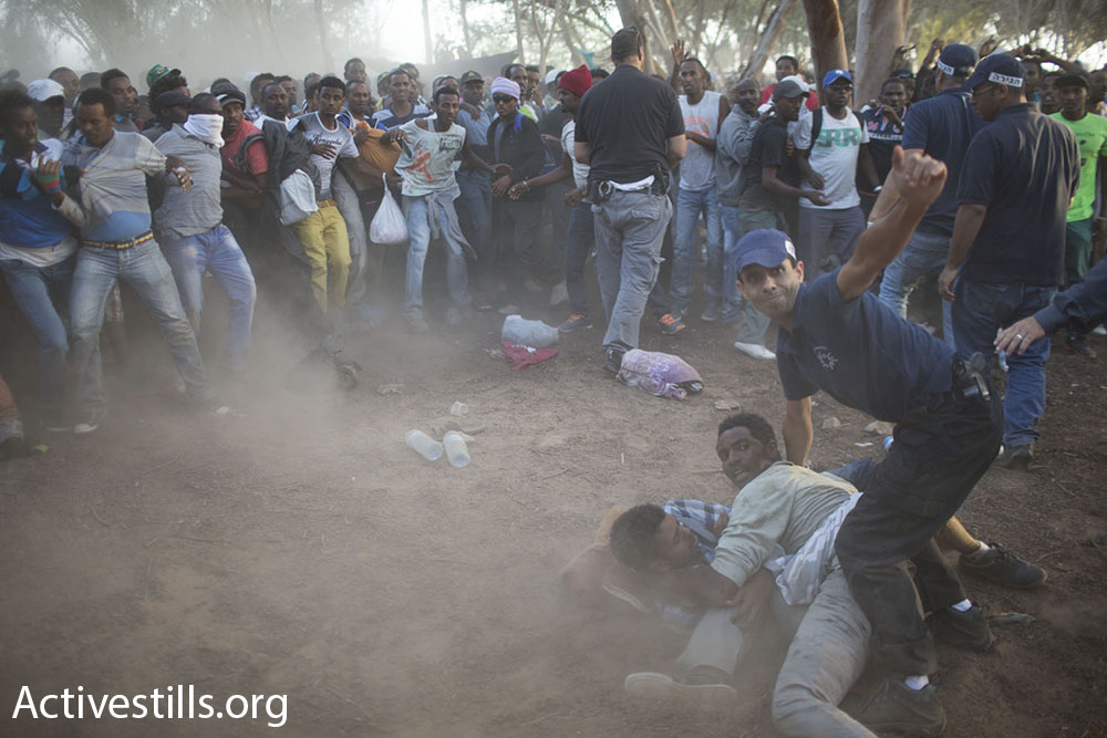 Israeli police and immigration officers arrest African asylum seekers at a makeshift encampment near the Egyptian border.