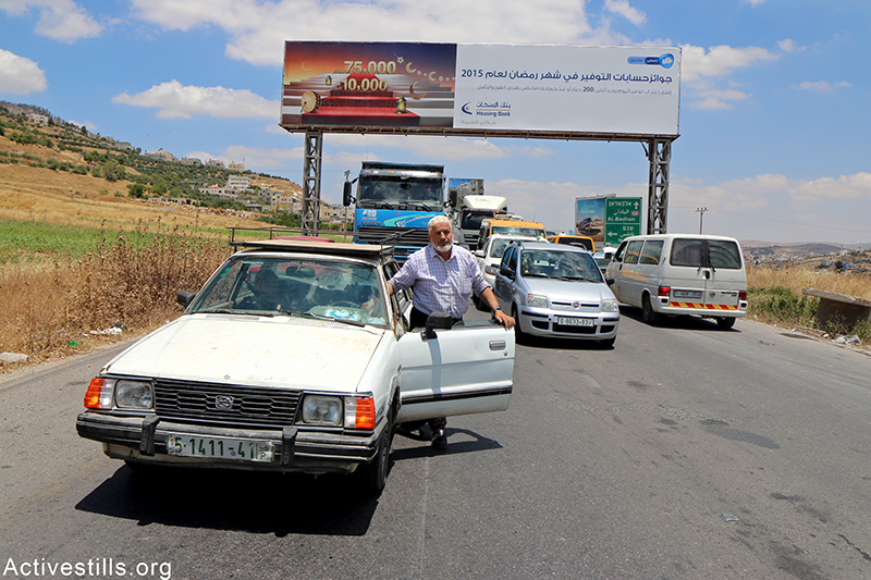 Israeli soldiers block Huwwara checkpoint, the main entrance of Nablus city, for 90 minutes, May 31, 2015. Israeli forces sealed the Nablus district and closed all its gates and checkpoint after contact was lost with an Israeli truck driver who was initially feared kidnapped, later resurfaced. Ahmad al-Bazz / Activestills.org