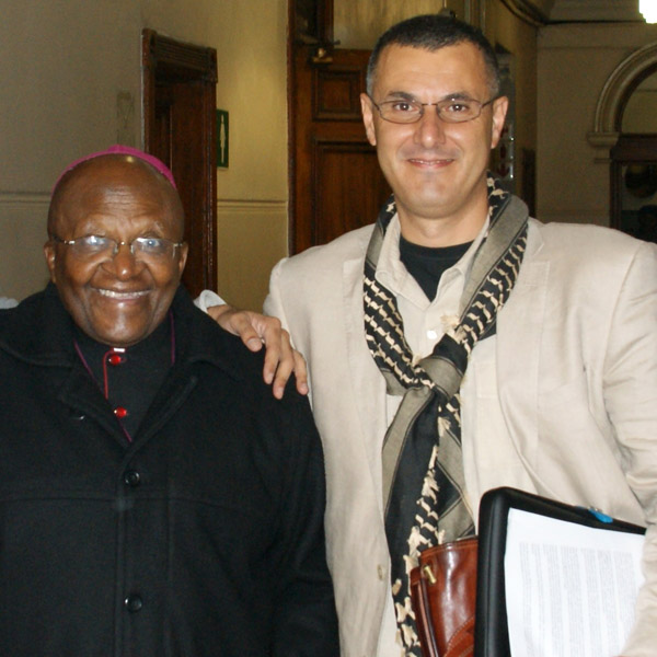 BDS Movement co-founder Omar Barghouti meets with Archbishop Desmond Tutu in Cape Town, South Africa in 2013. (Photo by Yazeed Kamaldien)