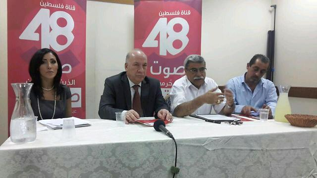Sanaa Hammoud (left), and Palestinian Communications Minister Riad Hassan (center) at a press conference for the launch of Palestine 48. (Courtesy photo)