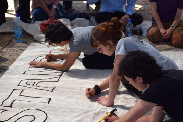 Activists with 'All That's Left' prepare a banner that will read, 'Stand With Susya,' June 13, 2015. (Photo by Michael Schaeffer Omer-Man)