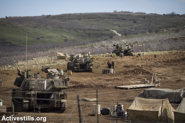 Israeli tanks positioned along the Syrian border in the occupied Golan Heights, January 29, 2015. (Photo by Oren Ziv/Activestills.org)
