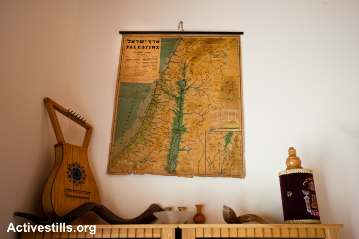 A map of Palestine hangs on the wall in the home of a Dutch-born settler in the Israeli settlement of Susya, West Bank, April 6, 2011 Located next to the Palestinian village of the similar name, like all Israeli settlements it is considered illegal under international law.