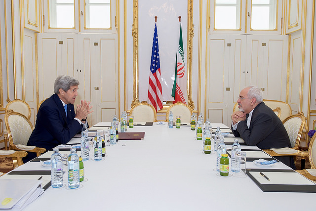 .S. Secretary of State John Kerry sits across from Iranian Foreign Minister Javad Zarif on June 30, 2015, in Vienna, Austria, before a one-on-one meeting amid negotiations about the future of Iran's nuclear program. (State Department photo)