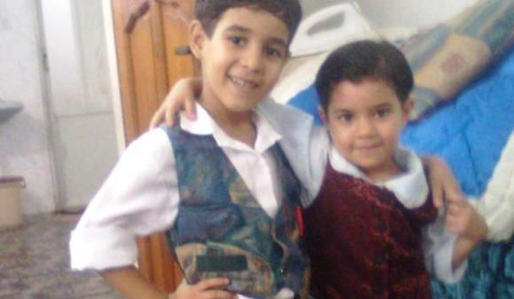 Ali Al-Awour, 10, pictured on the left with his youngest sister, died on 14 June 2014 of wounds he sustained from an Israeli airstrike. (photo: Defense for Children International-Palestine)