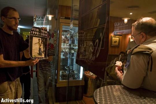 Israeli protesters interrupt Avi Benayahu during a talk in 2008. (photo: Oren Ziv/Activestills.org)