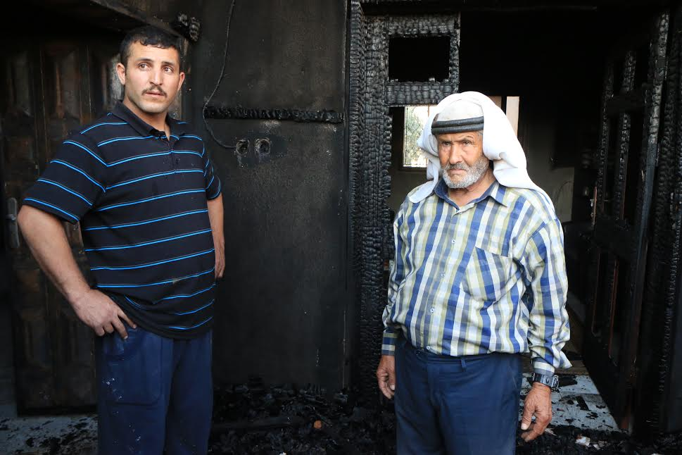 Relatives of Ali Saad Daobasa, the Palestinian baby who was killed in an arson attack by Israeli settlers, are seen in the Daobasa family home, just hours after the attack, July 31, 2015. (photo: Ahmad Al-Bazz.)