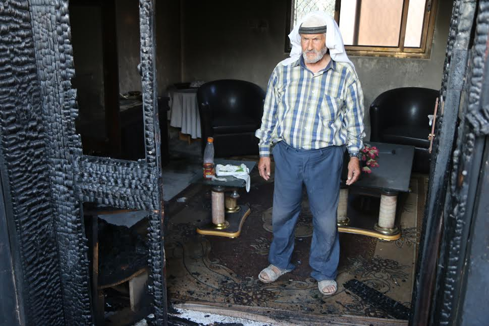 A relatives of Ali Saad Daobasa, the Palestinian baby who was killed in an arson attack by Israeli settlers, are seen in the Daobasa family home, just hours after the attack, July 31, 2015. (photo: Ahmad Al-Bazz.)