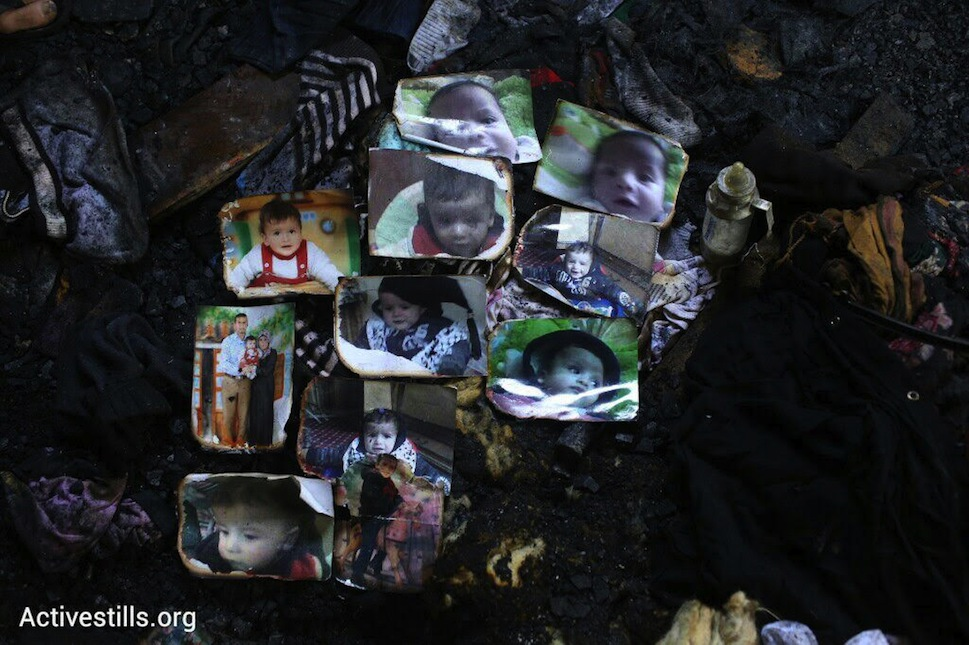 Photographs of Ali Saad Dawabsha, the Palestinian baby in an overnight arson attack, are laid out on the floor of his family home, Douma, West Bank, July 31, 2015. (photo: Oren Ziv/Activestills.org)