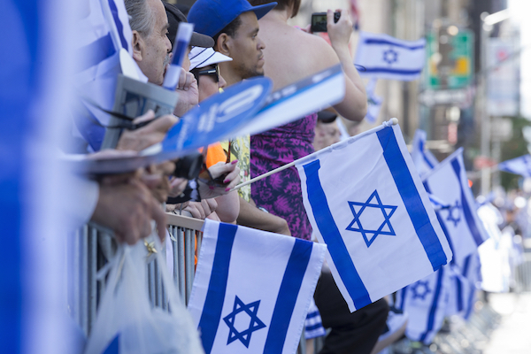 Bystanders at the 50th annual Israel Day parade on 5th Avenue in New York City, June 1, 2014. (Photo by Lev Radi/Shutterstock.com)