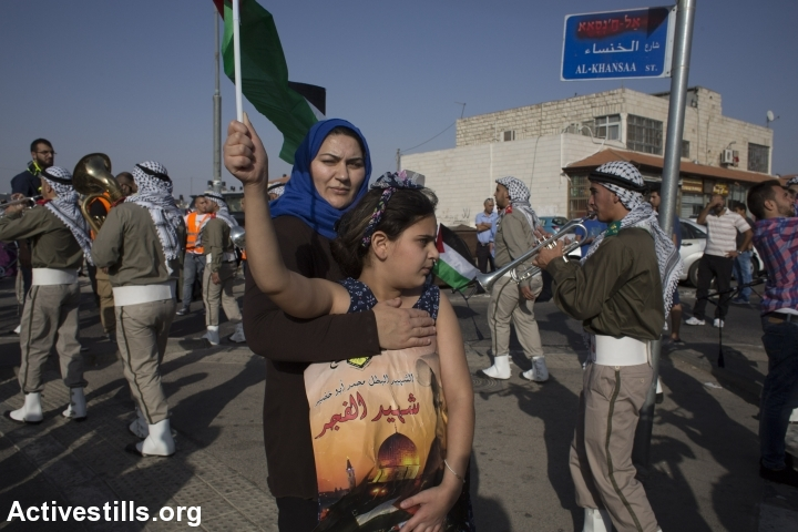 Palestinians take part in a demonstration in Shuafat, in East Jerusalem, July 2, 2015 to mark the first anniversary of the killing of 16-year-old Palestinian Mohammed Abu Khdeir, who was snatched and burned alive by Jewish extremists in an act of revenge after the abduction and murder of three young Israelis. (photo: Oren Ziv/Activestills.org)
