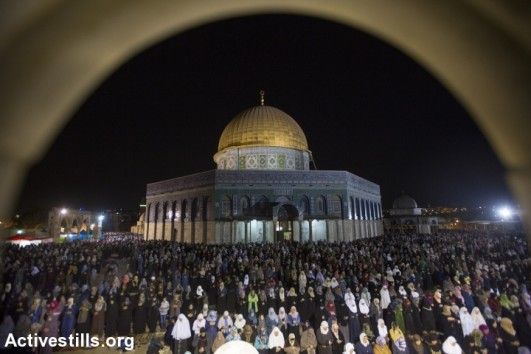 Palestinian Muslim worshippers pray overnight, July 13, 2015 outside the Dome of the Rock in the Al-Aqsa mosque compound in Jerusalem's Old City during Laylat al-Qadr which falls on the 27th day of the fasting month of Ramadan, July 13, 2015. (photo: Faiz Abu Rmeleh/Activestills.org)