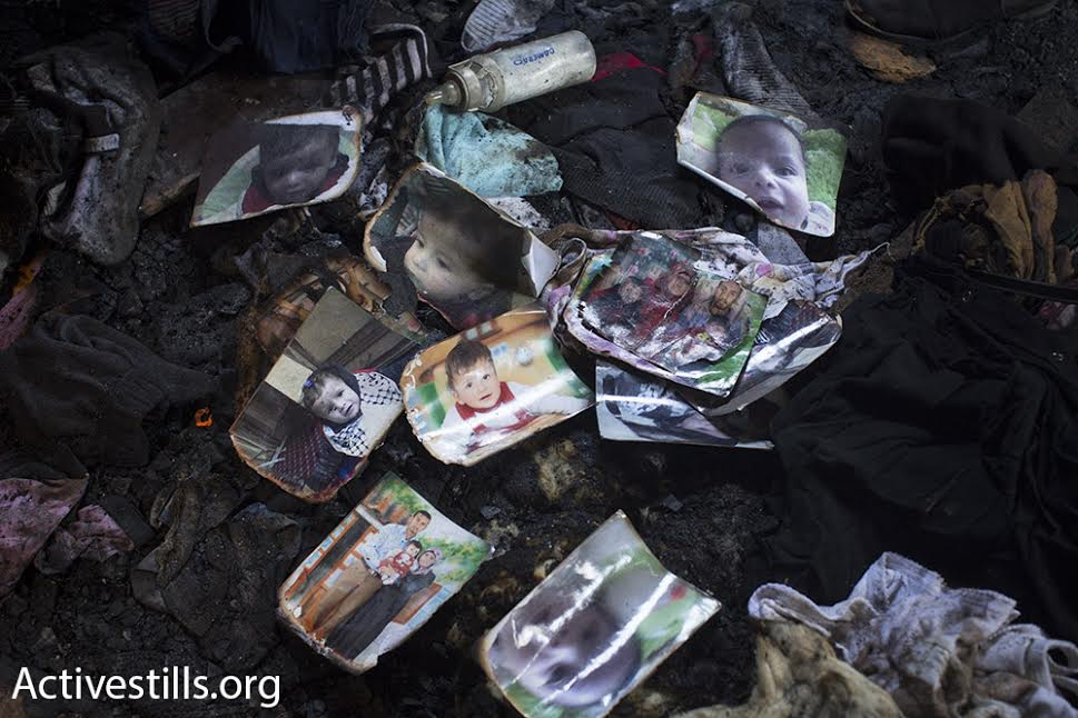 Relatives laid dozens of photos of 18-month-old Ali Saad Dawabshe in memorial to the slain toddler, Duma, West Bank, July 31, 2015. (photo: Oren Ziv/Activestills.org)