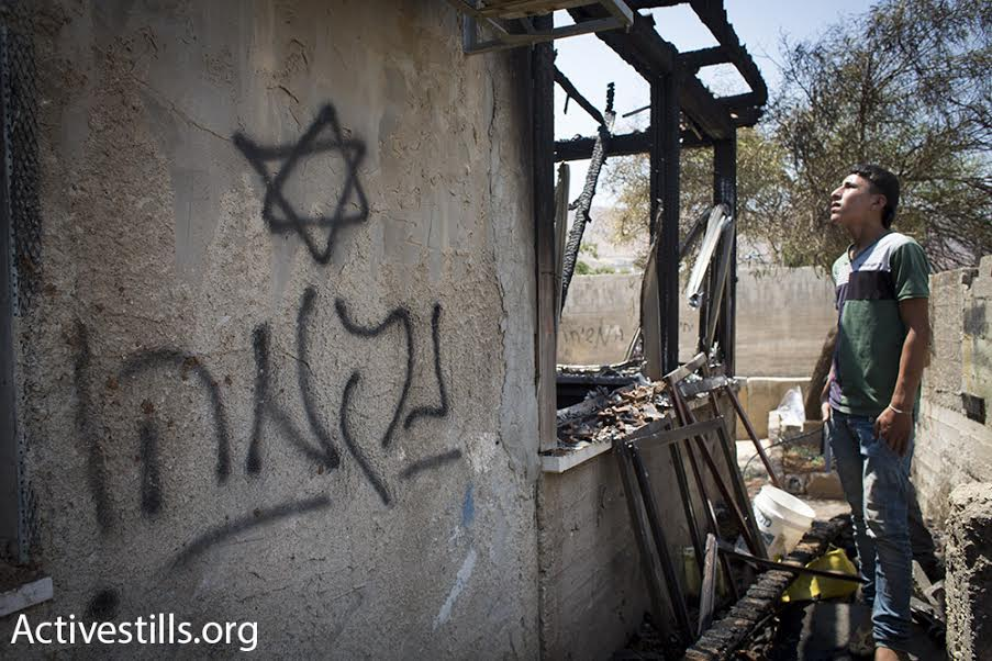 The word 'revenge' is seen graffitied on the wall of the Dawabshe house, Duma, West Bank, July 31, 2015. (photo: Oren Ziv/Activestills.org)