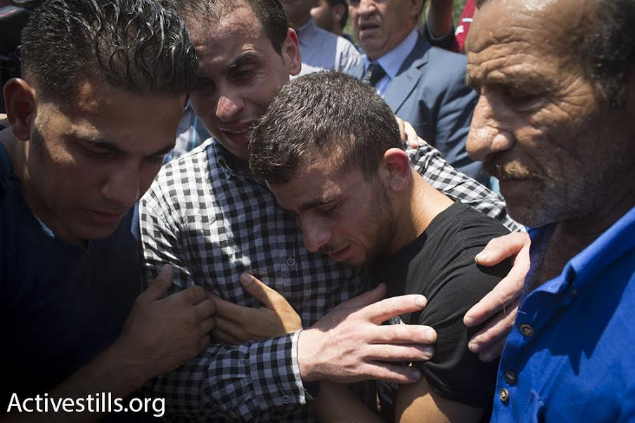 Palestinians mourn during the funeral march for Palestinian baby Ali Saad Dawabshe, Duma, West Bank, July 31, 2015. (photo: Oren Ziv/Activestills.org)