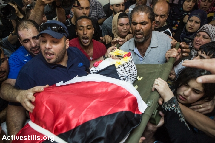 Family members of 17-year-old Mohammed Sami al-Ksbeh mourns during his funeral in Qalandiya refugee camp, near the West Bank city of Ramallah July 3, 2015. A senior Israeli army officer shot and killed Ksbeh who was throwing stones near a checkpoint in the West Bank on Friday, June 3, 2015. (photo: Yotam Ronen/Activestills.org)