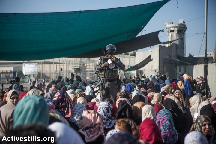 Palestinians cross the Qalandiya checkpoint between the West Bank city of Ramallah and Jerusalem on their way to pray at the Al-Aqsa Mosque in Jerusalem, on the third Friday of the Muslim holy month of Ramadan, July 3, 2015. (photo: Yotam Ronen/Activestills.org)