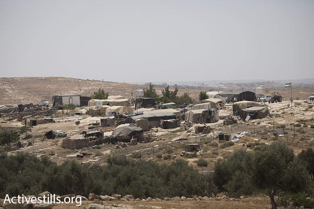 A view of the tents that comprise most of Susya, July 24, 2015. (Oren Ziv/Activestills.org) Israeli authorities reject 90 percent of Palestinian planning requests, which means that almost all new Palestinian homes in the area are built without permits, putting them at risk of demolition.