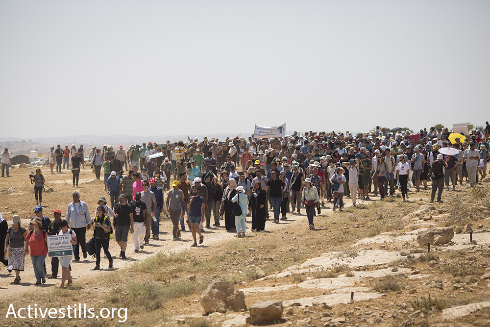 Hundreds of Palestinian, Israeli and international activists march into the Palestinian village of Susya, demanding that Israel not demolish it, Suysa, South Hebron Hills, July 24, 2015. (Oren Ziv/Activestills.org)
