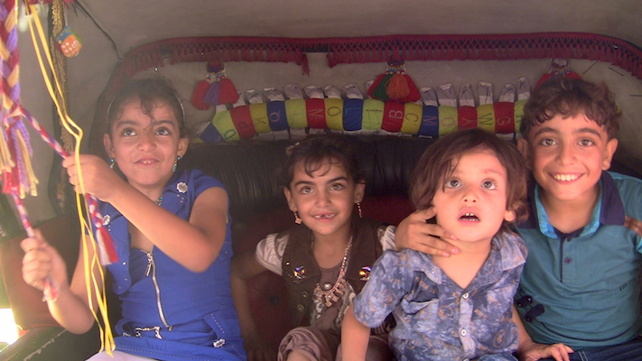 The Awajah chlldren enjoying a horse-and-buggy ride in Gaza City to celebrate the Eid holiday. (Photo by Jen Marlowe)