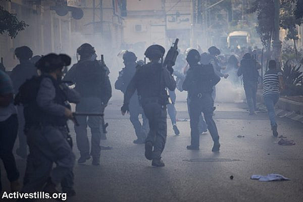 Israeli border police shoot tear gas at an anti-war protest organized by Palestinian citizens of Israel, Nazareth. At least 10 were arrested. (photo: Oren Ziv/Activestills.org)