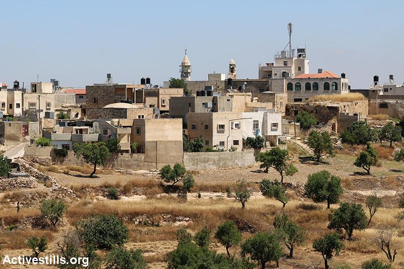 View on Qaryut village, West Bank, June 6, 2015. (Activestills.org)