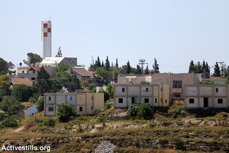 New housing units at the Israeli settlement of Shilo, Qaryut village, West Bank, June 6, 2015. (Activestills.org)