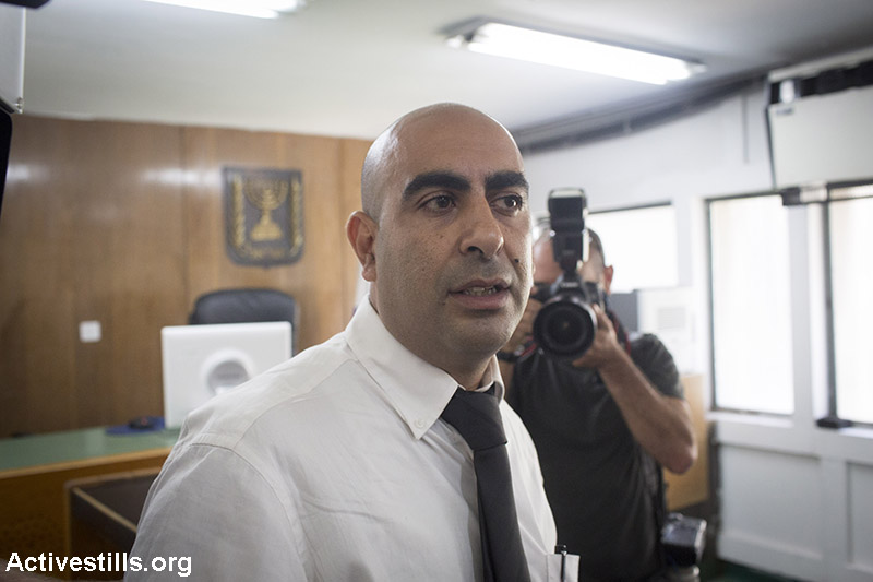 Activist Barak Cohen is seen in the Tel Aviv court, as Rakefet Russak Aminoach, President of bank Leumi, appeals to ban activist Barak Cohen from  protesting near her and her family, June 18, 2015. (Activestills.org)