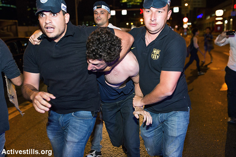 Police arrest a protester during a protest against natural gas privatisation in Tel Aviv, June 27, 2015. Around 4000 people marched in protest of the government's policies regarding the privatisation of natural gas found in the Mediterranean sea. (Activestills.org)