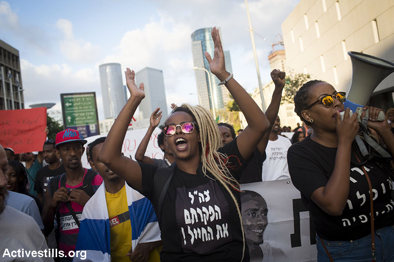 Israeli Ethiopians and activists protest against police violence and racism in centre Tel Aviv, June 22, 2015. Protesters blocked roads near Rabin square. Police violently arrested at least 15 activists. (Activestills.org)
