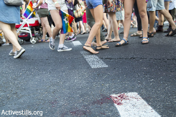 Blood is seen on the pavement following a mass stabbing attack against the Jerusalem LGBTQ Pride Parade in Jerusalem, July 30, 2015. (Keren Manor/Activestills.org)