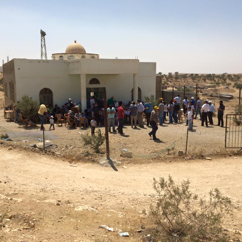 Protesters march as construction begins for Jewish town to   replace Bedouin village. August 27, 2015. (Amjad Iraqi / Adalah)