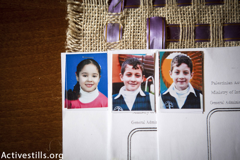 Photos of Afnan Wesam Shuheebar (8), Jehad Issam Shuheebar (11), and his brother Wassem (8) seen in Afnan's home in Gaza city, November 17, 2015. The three children were killed during an Israeli attack on July 17, 2015, while the children were feeding birds on the roof of the family's home. (Anne Paq / Activestills.org)