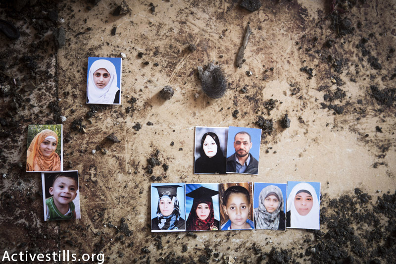 Photos of 10 members of the Balata family seen in the ruins of the home of Abdel Kareem Balata, Jabaliya refugee camp, Gaza Strip, September 9, 2014. A total of 11 members of the family were killed, including 9 members belonging Naeem Balata's immediate family. Naeem, his wife, and seven of their children were killed by Israeli shelling on his brother's home on July 29, 2014. (Anne Paq / Activestills.org)