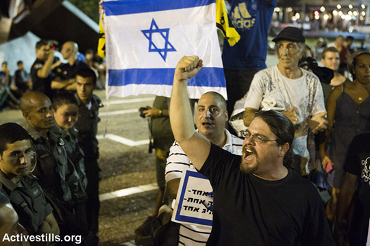 Israeli right-wing protesters shout at a pro-peace demonstration, Rabin Square, Tel Aviv, August 9, 2014.Hundreds gathered in Tel Aviv to protest Israel's attack on Gaza, despite a police decision to revoke the demonstration permit. (Keren Manor/Activestills)