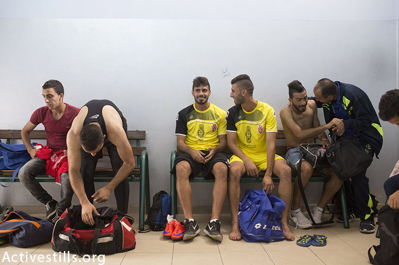 Hebron's Al-Ahly's players prepare before their championship match against Shejaiya, Gaza in the Palestine Cup final, August 14, 2015, at Hussein Bin Ali Stadium in the West Bank city of Hebron. (photo by: Oren Ziv/Activestills.org)