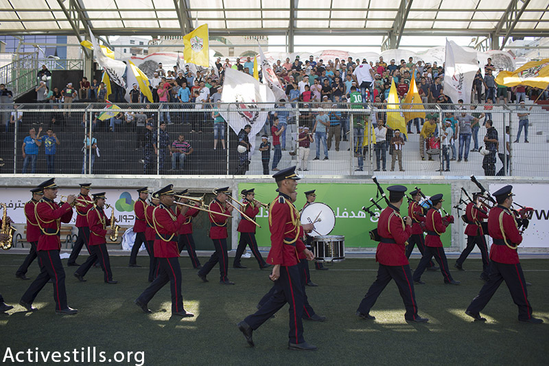 A band plays music during the Palestine Cup between Shejaiya and Al-Ahly Hebron, August 14, 2015, Hebron, West Bank. (photo by: Oren Ziv/Activestills.org)