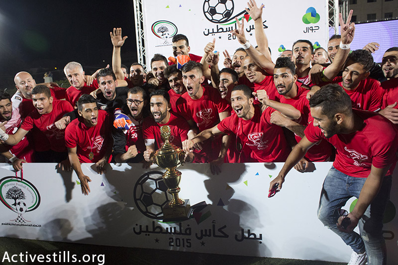 Al Ahly team players celebrate after defeating Gaza's Shejaia, Hebron, West Bank, August 14, 2015 . (photo by: Oren Ziv/Activestills.org)